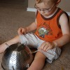 Keep a toddler busy with a colander